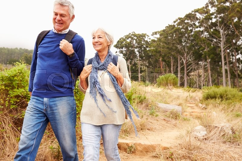 Senior couple walking together in a forest, close-up, stock photo