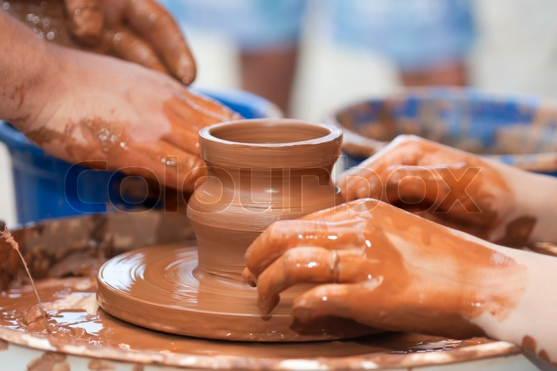Stock image of 'Pottery craft wheel ceramic clay potter human hand'