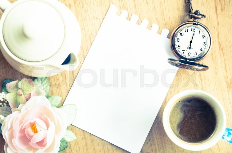 Blank Pad of Paper ready for your own text, pocket watch & Coffee. Vintage style, stock photo