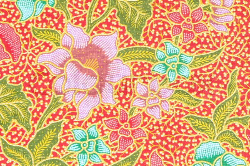 flower pattern background on batik stock photo