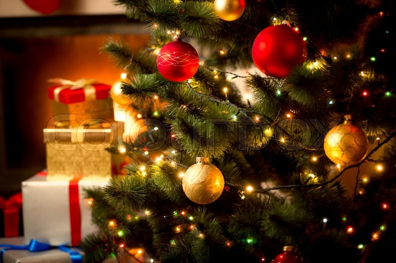 Christmas background with illuminated fir tree and fireplace at house, stock photo