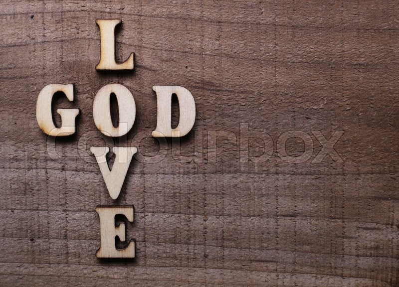 God Is Love Concept Text Lying On The Rustic Wooden Background