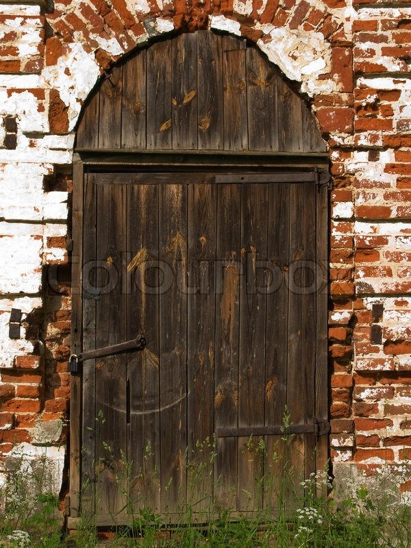 Old Church Closed Entrance With Wood Stock Photo