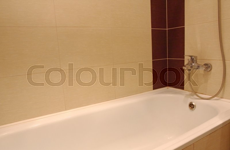 Bath tub detail with chrome faucet, stock photo