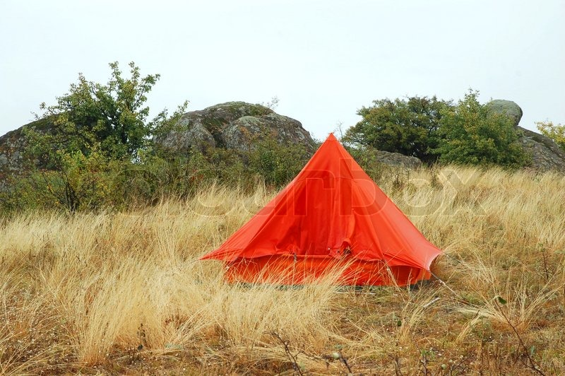 & Orange tourist tent in the white grass | Stock Photo | Colourbox