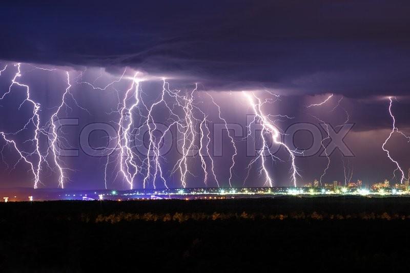 Night thunder lightning over the city sky view, stock photo