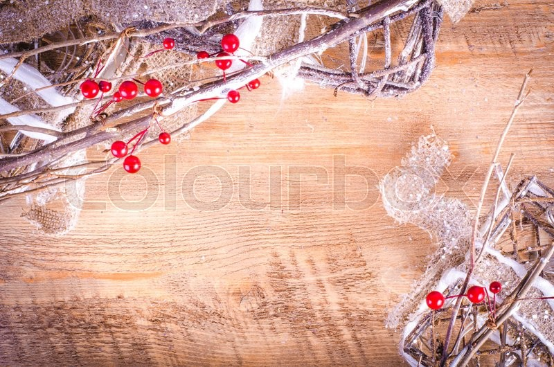 Christmas rustic light boxes on wooden background, snowy wreath. Christmas and New Year decoration frame. Free space for text, stock photo