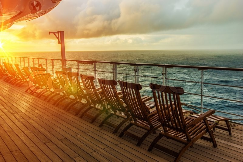 Cruise Ship Wooden Deck Chairs. Cruise Ship Main Deck at Sunset, stock photo