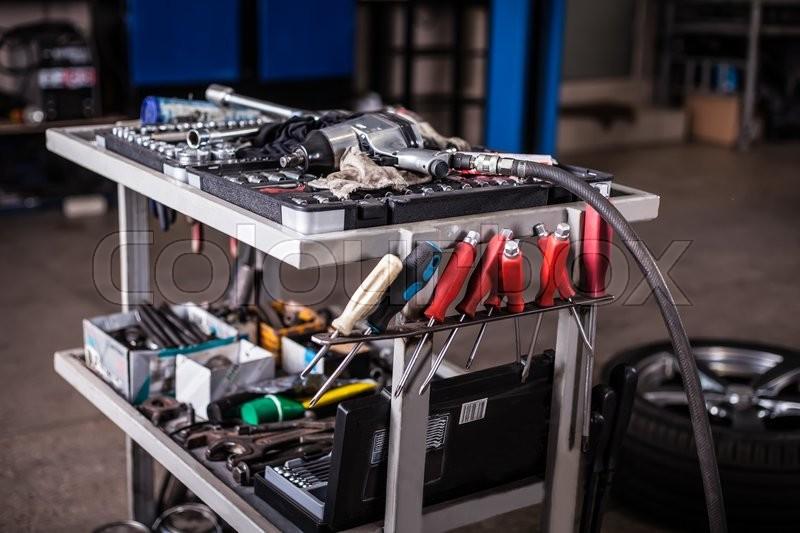 Assortment kit of tools in mechanic garage car service, stock photo