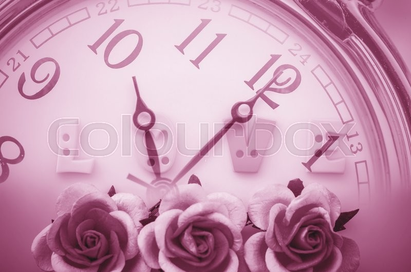 Vintage pink roses flower and love face time background. Time and love concept, stock photo