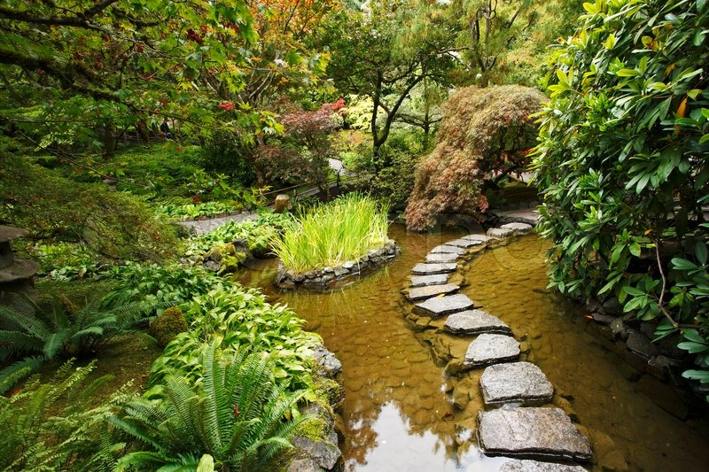 Traditional japanese garden a stream and a decorative for Traditional japanese garden