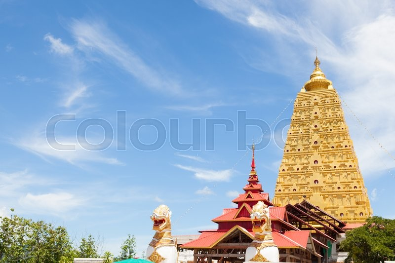 Large yellow pagoda Temple Sagklaburi Mon Art of the attractions. In the afternoon, the sky was clear, stock photo
