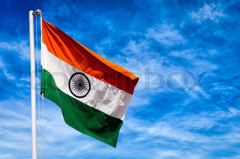 india symbol indian flag against blue sky stock photo colourbox