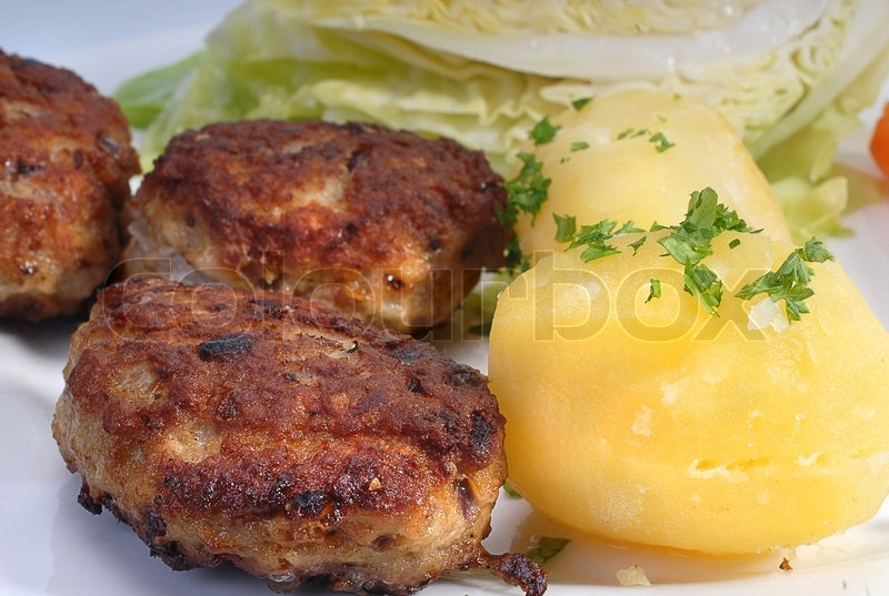 Closeup of danish meatballs (frikadeller) and potatoes ...