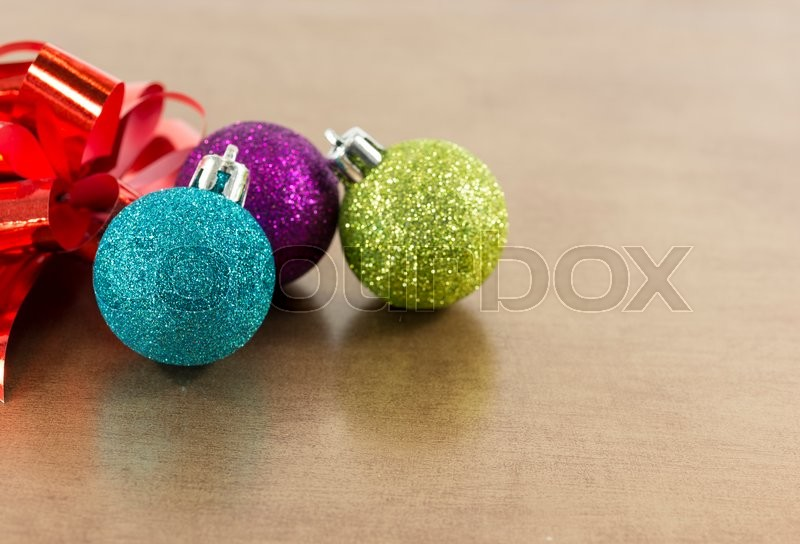 Blue,pink and green christmas balls on brown gold background, stock photo