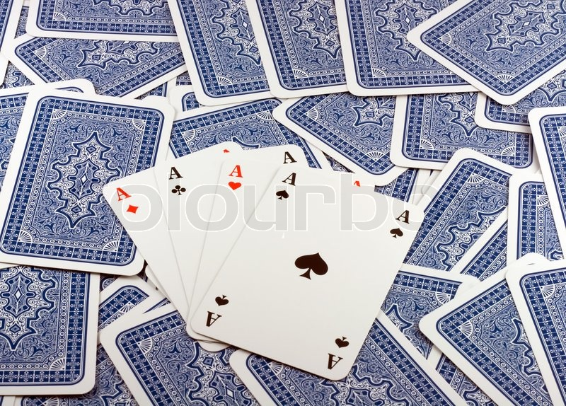 Four Aces in Background scattered Playing Card Back , stock photo