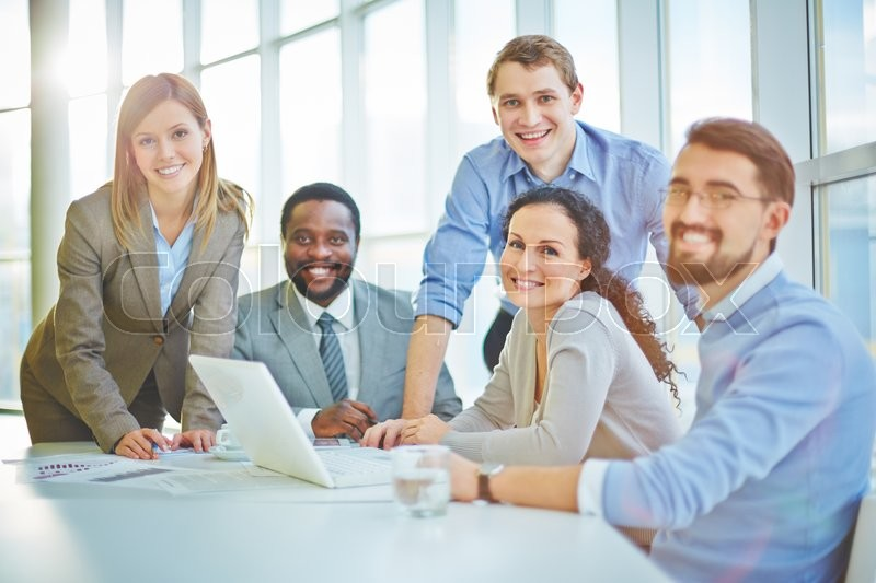 Modern business people sitting at workplace, stock photo