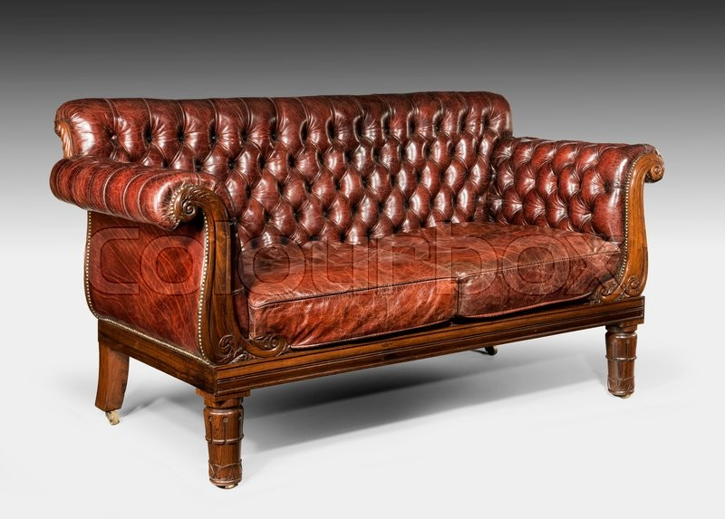 Antique old vintage brown leather studded cushioned couch sofa, stock photo