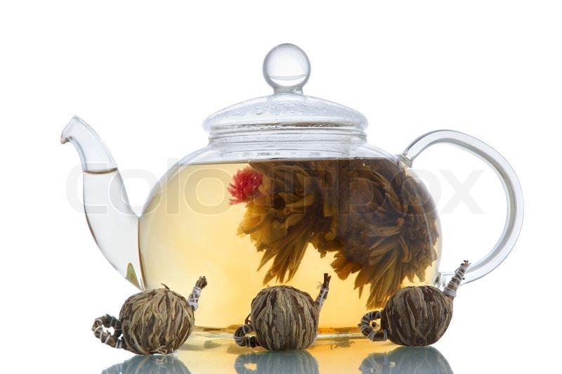 Glas Teekanne glas teekanne mit blühenden blume grün teekannen auf weißem