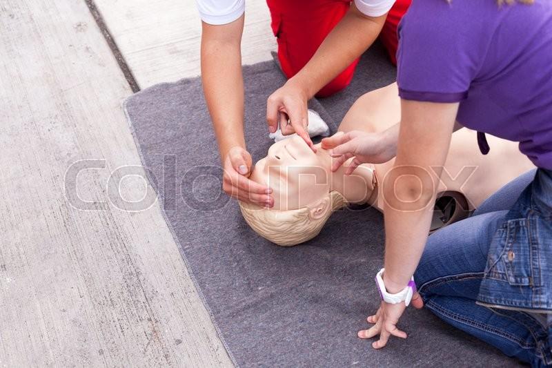 Cardiopulmonary resuscitation (CPR). First aid training, stock photo
