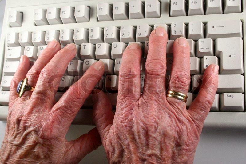 Elderly Man S Hands Typing On Laptop Keyboard Stock