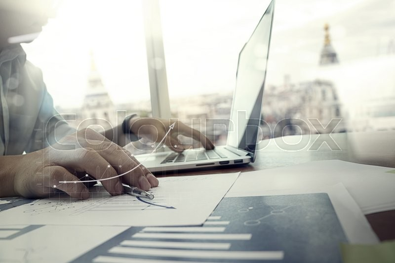 Business documents on office table with smart phone and digital tablet and graph business with social network diagram and man working in the background, stock photo