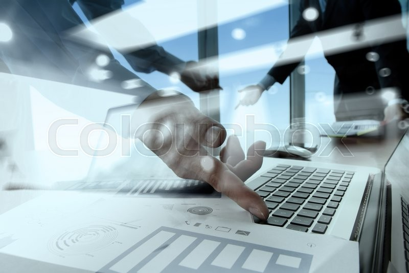 Double exposure of business documents on office table with smart phone and digital tablet and stylus and two colleagues discussing data in the background, stock photo