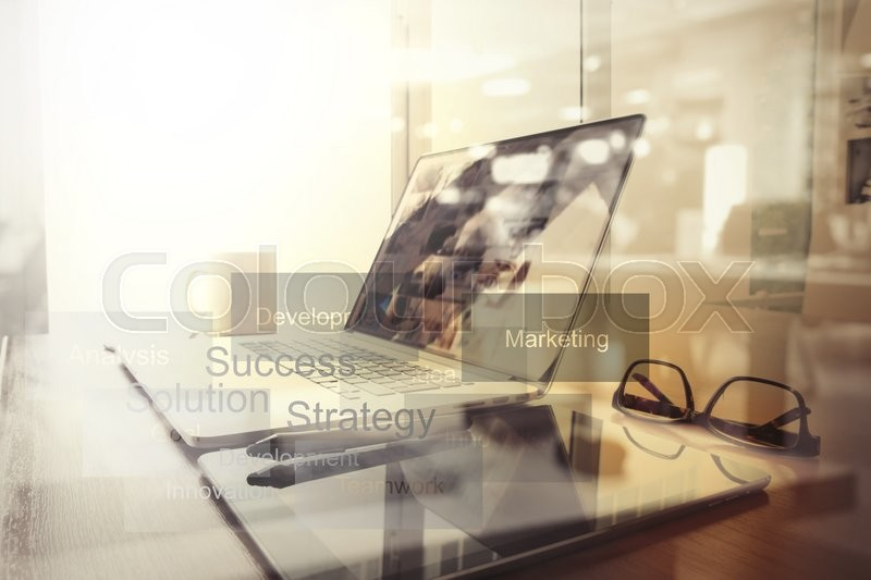 Business documents on office table with smart phone and digital tablet and graph business diagram and man working in the background, stock photo