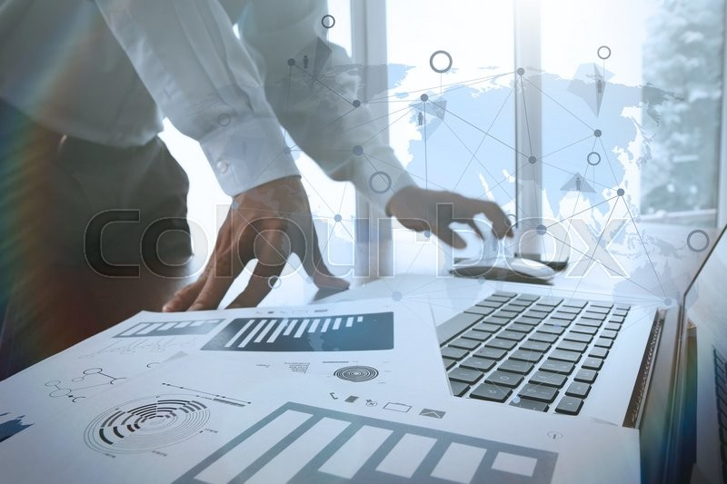 Business documents on office table with smart phone and digital tablet and graph business diagram and man working in the background with social media diagram, stock photo