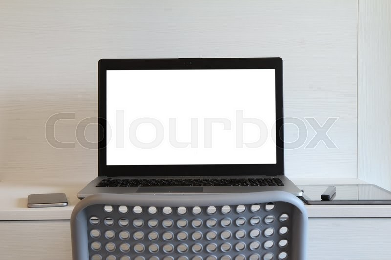 Blank screen laptop computer with table lamp is on twooden desk as workplace concept, stock photo