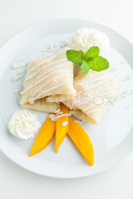 ... crepes filled with fresh mango sticky rice and a scoop of coconut ice