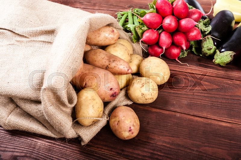 Vegetables on wood background with space for text. Organic food, stock photo