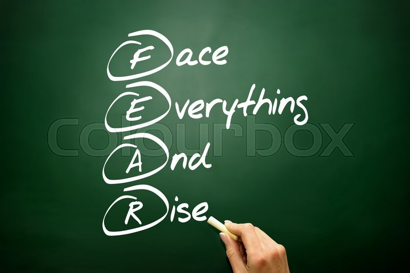 Hand drawn Face Everything And Rise (FEAR) acronym, business concept on blackboard, stock photo