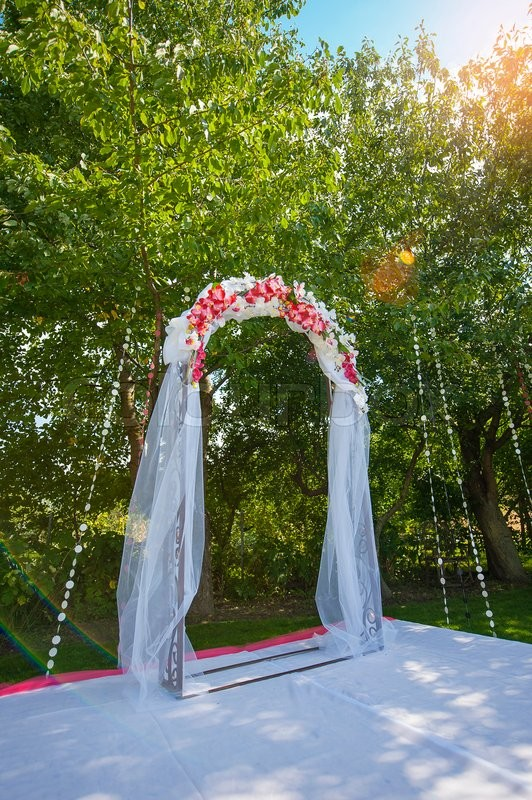 Arch for the wedding ceremony. Floristic composition in vintage style. The Provence. , stock photo