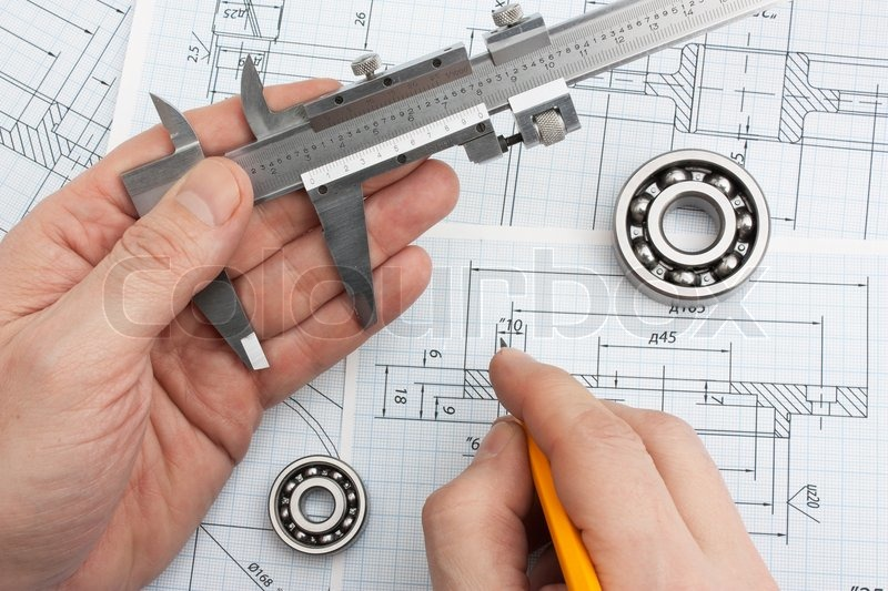 Technical drawing and tools in hand | Stock Photo | Colourbox