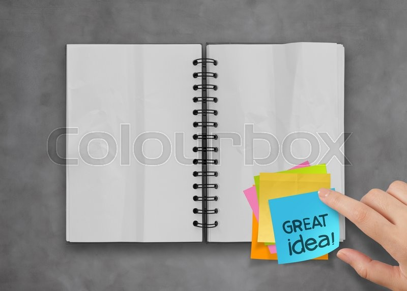 Great idea word sticky notes with open blank note book on desk top texture, stock photo
