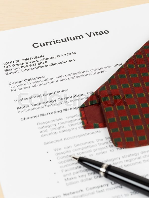 Curriculum vitae or CV with pen, and neck tie; concept job applying; document is mock-up, stock photo