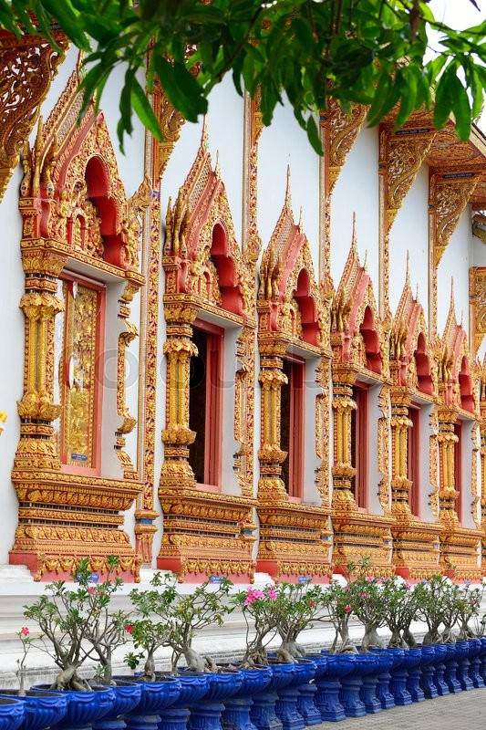 Sculpture on the window temple of buddhism, Wat Mahawan temple in Lamphun, Northern Thailand, Thailand, stock photo
