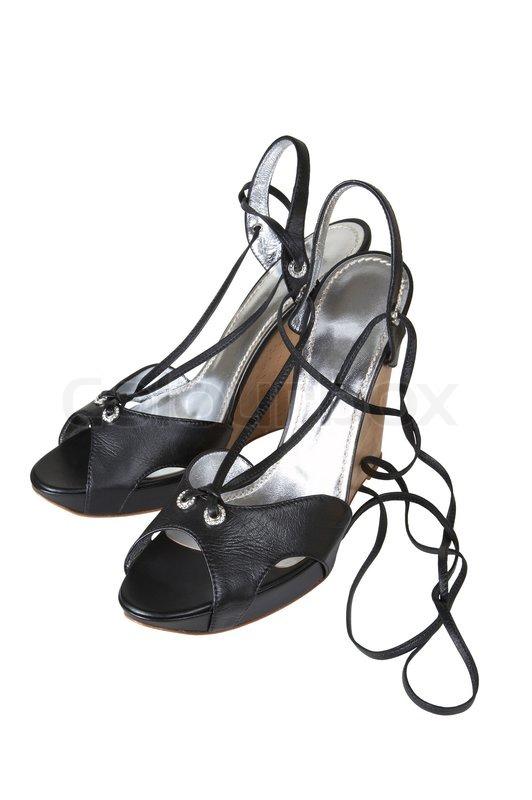 8010878465a7 Stock foto af  Sorte sko med et langt bælte på en hvid baggrund