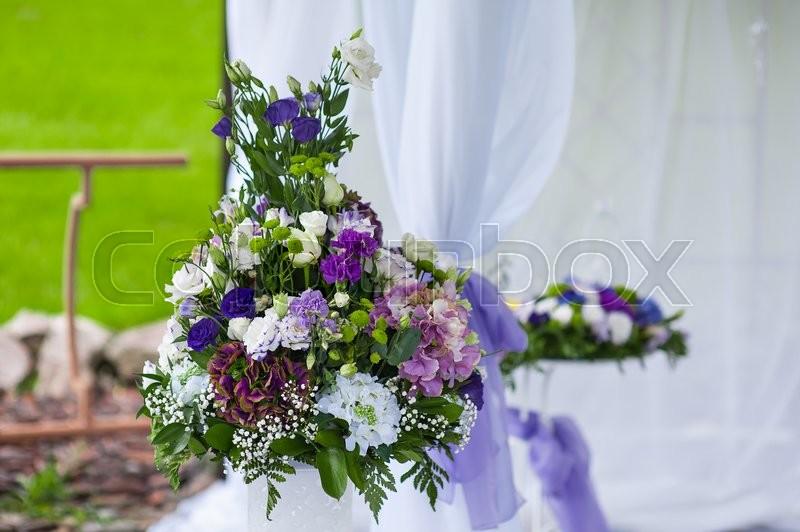 Wedding arrangement of purple flowers, stock photo