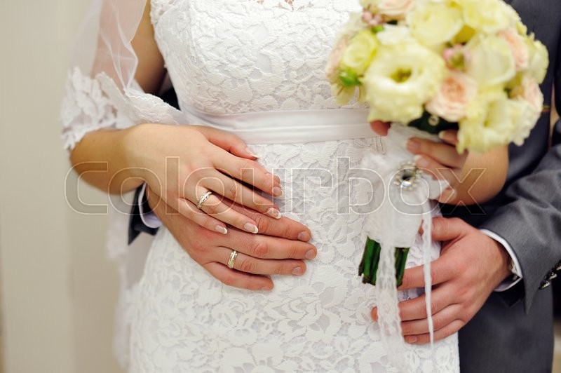Hands of the bride and groom with wedding rings, stock photo