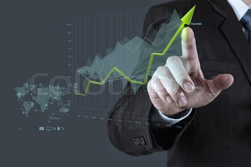 Businessman hand draws business success chart concept on virtual screen, stock photo