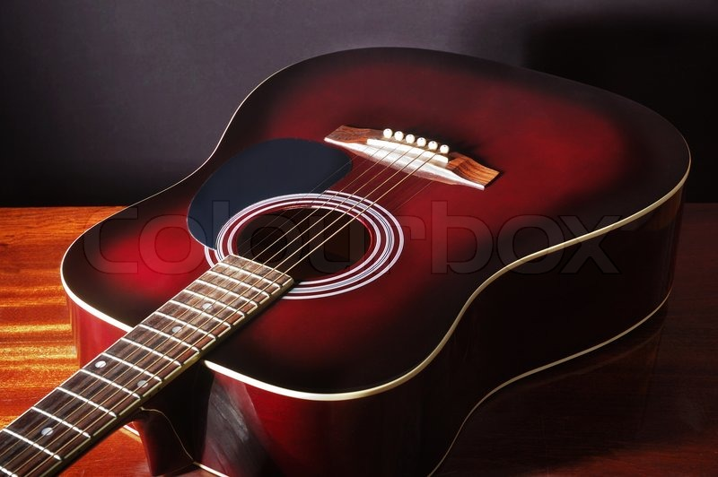 Detail Of A Red Guitar On Dark Background