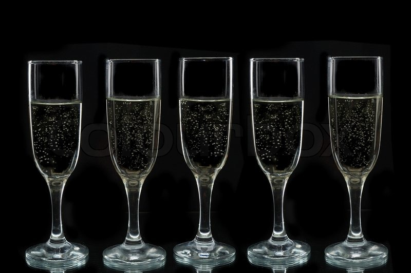 Champagne flutes against a black background, stock photo