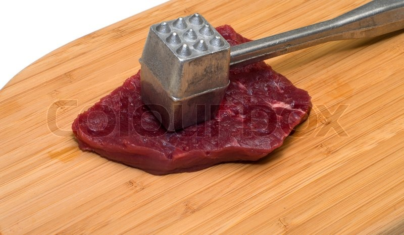 Gentil Piece Of Beef And A Kitchen Mallet On A Wooden Cutting Board. | Stock Photo  | Colourbox