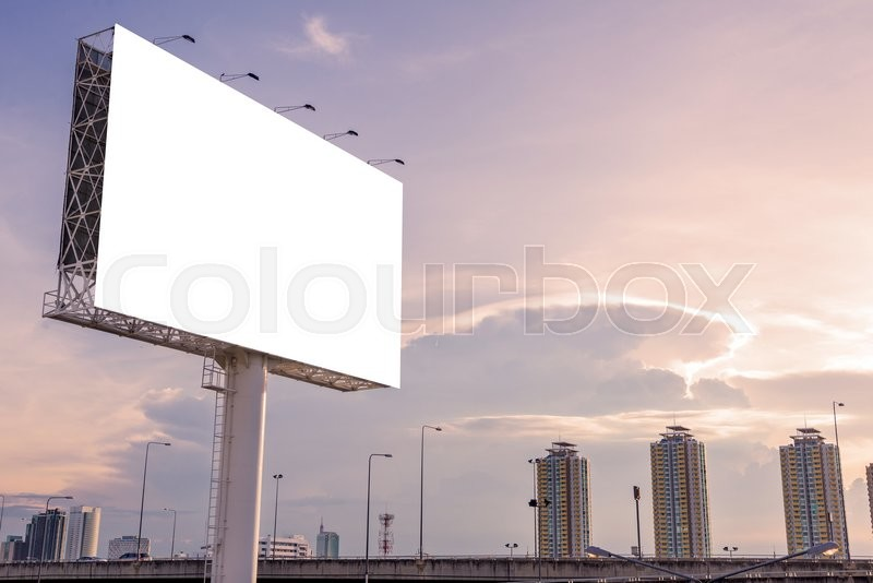 Large blank billboard on building in city view background, stock photo