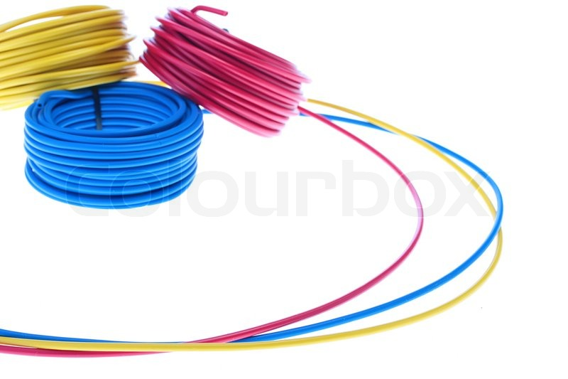 Red, dark blue and yellow wires of retinue in rings for storage ...