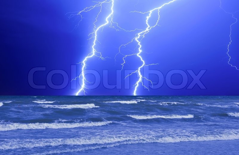 Thunderstorm And Perfect Lightning Over The Wave Ocean