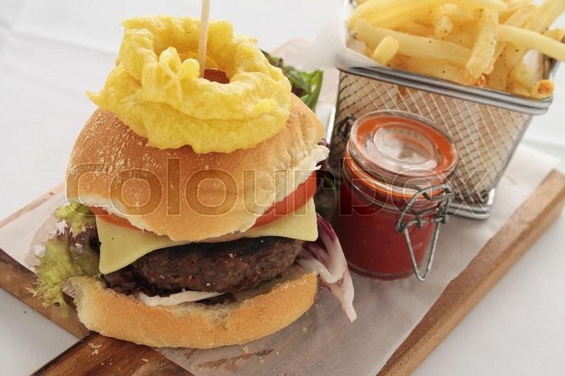 Gourmet burger plated meal, stock photo