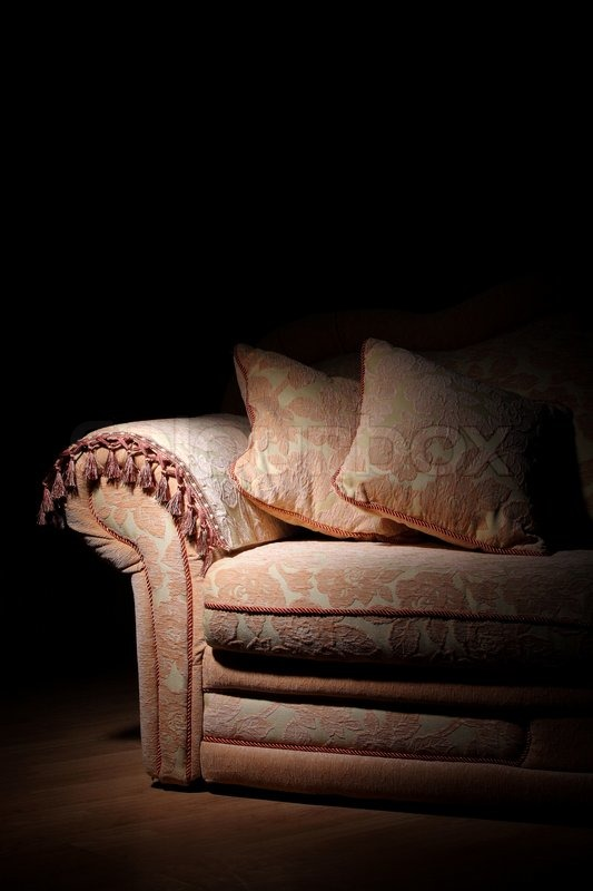 Soft Sofa With Pillows In A Dark Room Stock Photo